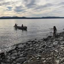 Dusk beach w canoe